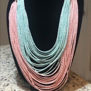 A set of two beaded pink and blue potay necklaces